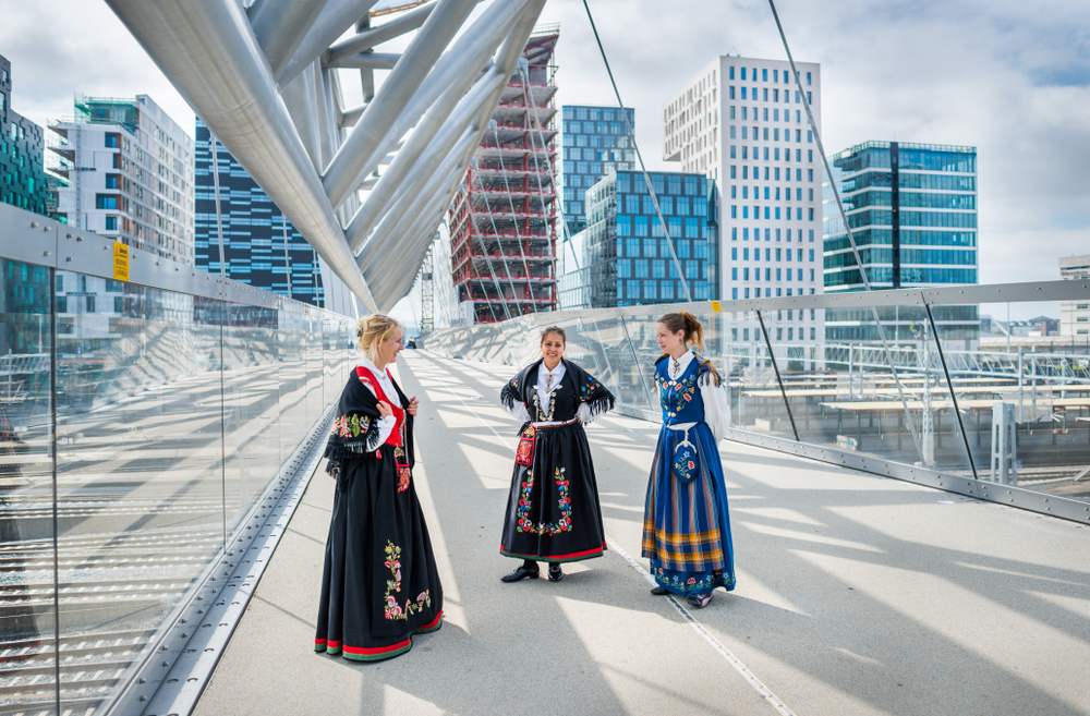 Traditional Norwegian bunad dresses in modern Oslo